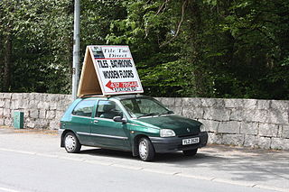Car with sign on roof